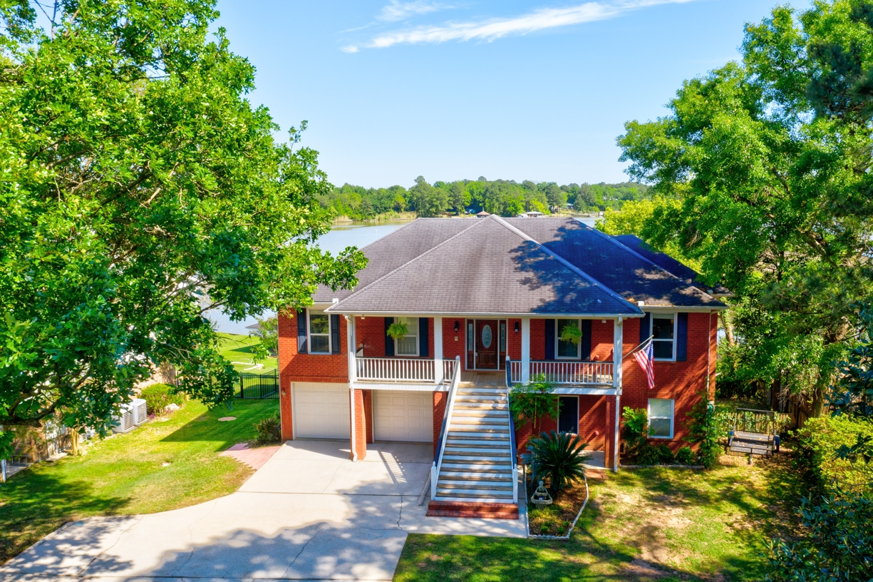 Aerial Property Photo of House on Water