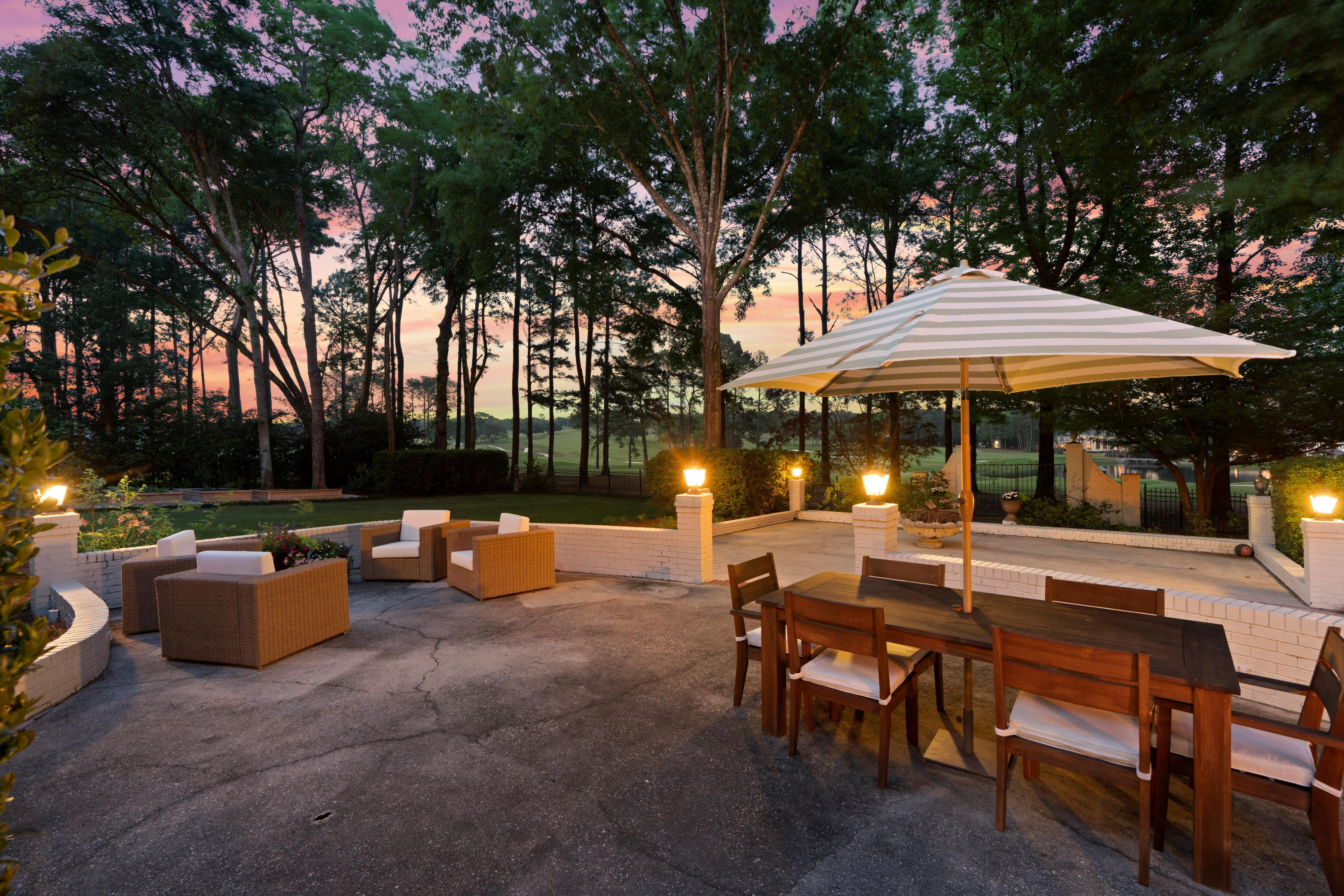 Real Estate Exterior Patio at Sunset looking at golf course